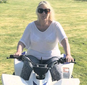 ??  ?? Outward bound Lesley McGown on her quad bike before it was stolen