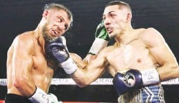 ??  ?? UNDISPUTED CHAMP – Unbeaten Teofimo Lopez, right, connects with a right uppercut against Ukraine's Vasiliy Lomachenko in their world lightweight unification title fight in Las Vegas yesterday. Lopez won via unanimous decision. (Top Rank photo)
