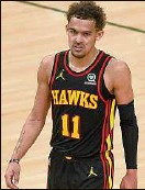 ?? Patrick Mcdermott / Getty Images ?? Trae Young of the Hawks was limited to 15 points with nine turnovers in Game 2 after scoring 48 points in Game 1.