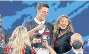 ?? AFP ?? Tom Brady celebrates with his wife Gisele Bundchen after winning the 2021 Super Bowl last month.