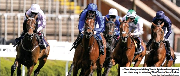 ?? Picture: Alan Crowhurst/Getty Images ?? Tom Marquand riding Youth Spirit (white/green) on their way to winning The Chester Vase Stakes