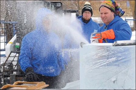 ?? WAYNE EMDE/Special to The Daily Courier ?? Carver Ryan Cook trims the end of one of nine 300-pound blocks of ice that will be transformed into a carving of Woody and his horse from the Toy Story movies.