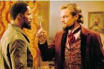 ?? THE WEINSTEIN COMPANY ?? Jamie Foxx, at left, and Leonardo DiCaprio in Quentin Tarantino's Django Unchained. It's a spaghetti western focused on slavery in the U.S.