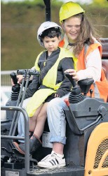 ??  ?? Digging it . . . Scarlett Ingram (13) and her cousin Xavier Spinner (4), both of Dunedin, have a go at being excavator operators.