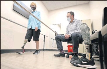 ?? ALEXA WELCH EDLUND/TIMES-DISPATCH ?? Daniel Mejia checks out the fit of Saule Sadykova's new prosthesis. Last year the pandemic prevented Victoria Charbonneau, a native of Midlothian, from bringing Saule from Kazakhstan to be fitted for a new prosthesis.