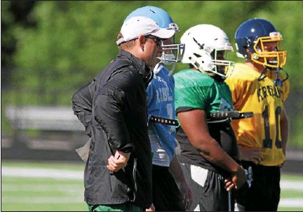 ?? MICHAEL JOHNSON - THE NEWS-HERALD ?? Larry Pinto, who retired as Mayfield coach in January, chats with members of the White team during practice for The News-Herald Senior Bowl on June 12 at Mayfield High School. The game is June 17. Check out a photo gallery from June 11 practice at...