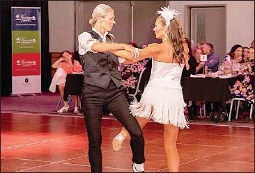 ??  ?? Georgie Bruce and dance partner Charli Ivc delivered a dazzling ballroom performance at the Stars of the Border Dance for Cancer fundraiser event in Albury last Friday.