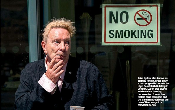 ??  ?? John Lydon, also known as Johnny Rotten, drags down a hasty cigarette outside the High Court Rolls Building in London. Lydon was giving evidence in a hearing between two former Sex Pistols band members and the band frontman over the use of their songs in a television series.