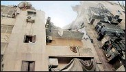 ??  ?? A view of a building damaged by what activists said was an air attack at Bustan al-Qasr neighbourhood in Aleppo (REUTERS)