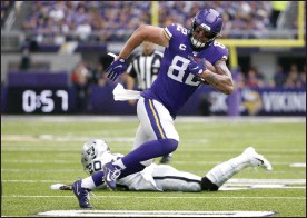 ?? BRUCE KLUCKHOHN - THE ASSOCIATED PRESS ?? FILE - In this Sept. 22, 2019, file photo, Minnesota Vikings tight end Kyle Rudolph (82) runs from Oakland Raiders cornerback Daryl Worley (20) after making a reception during the first half of an NFL football game in Minneapolis.
