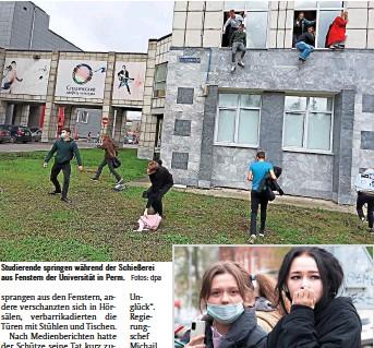 ??  ?? Studierende springen während der Schießerei aus Fenstern der Universität in Perm. Fotos: dpa Studentinnen stehen in der Nähe der Staatlichen Universität, an der ein Amokläufer sechs Menschen getötet hat.