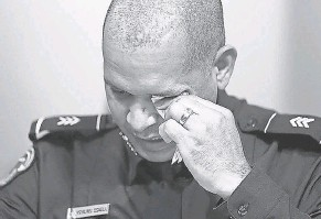 ?? AP ?? U. S. Capitol Police Sgt. Aquilino Gonell wipes his eyes at Tuesday's hearing.