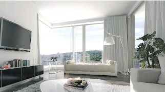 ??  ?? Floor-to-ceiling windows provide the Rocabella condos with plenty of natural light as well as some breathtaki­ng views of the city.