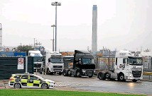 ?? GETTY IMAGES ?? Lorries are seen outside the Purfleet Thames Terminal on October 23, 2019 in Purfleet, Essex. Essex police said that a lorry containing 39 bodies, found in the nearby town of Grays, likely arrived in Purfleet overnight on a freight ferry from Zeebrugge, Belgium.