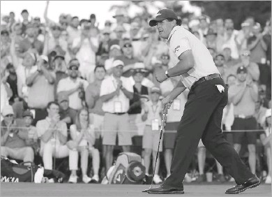 ?? Kevin C. Cox/getty Images ?? Phil Mickelson reacts after making a short birdie putt on the 18th green. It was the fifth birdie in seven holes for the threetime Masters champ and left him one stroke out of the lead shared by Bryson Dechambeau and Brooks Koepka.