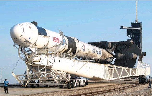 ?? Agence France-presse ?? ↑ A Spacex Falcon 9 rocket with the company's Crew Dragon spacecraft onboard is rolled out of the horizontal integration facility at Launch Complex 39A during preparations for the Crew-2 mission, on Friday at Kennedy Space Centre in Florida.
