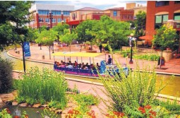 ?? COURTESY OF THE HISTORIC ARKANSAS RIVERWALK OF PUEBLO. ?? The Historic Arkansas Riverwalk of Pueblo is a 32-acre urban park filled with artwork. Boat and gondola rides are popular attractions on the river.