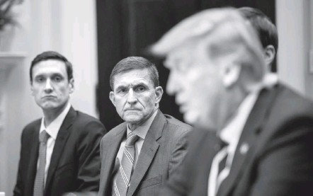 ?? JABIN BOTSFORD/THE WASHINGTON POST ?? Mike Flynn, center, then the national security adviser, listens as President Trump speaks during a meeting at the White House in January. Flynn has close ties to Jon Iadonisi, whose company worked on a Turkish consulting contract. Iadonisi also aided...