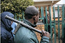 ??  ?? SCAPEGOATS Clockwise from far right: Angry South Africans block a road in Ramaphosa settlement, east of Johannesburg, as migrants became scapegoats for the government's failure to tackle crime, unemployment, lack of housing and poor service delivery. Dismembered mannequins in a shop destroyed by people rioting in Johannesburg for five days in September 2019. At least a dozen people were killed and many injured or displaced. The vigilante group 'Concerned Residents of Orange Grove and Alexandra' in August 2019 'evicted ' migrants they claimed had 'hijacked' properties from the Johannesburg Property Company. This man in Orange Grove said he was South African but was nonetheless forced out onto the pavement with all his possessions.