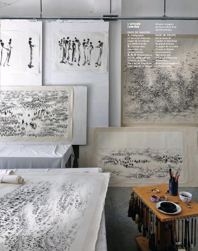 ??  ?? PAGE DE DROITE Sur les murs de l'atelier, la blancheur de grands formats en papier de riz noirci d'encre se déploie un peu partout. Migration, vols d'oiseaux, silhouettes mystérieuses… dessinent un imaginaire en mouvement.