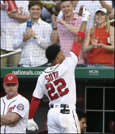 ??  ?? Washington Nationals' Juan Soto (22) takes a curtain call after he hit a three-run home run during the second inning of a baseball game against the San Diego Padres, on Monday, in Washington. AP PHOTO/NICK WASS