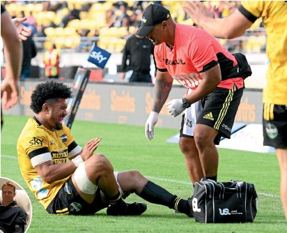?? PHOTOSPORT ?? Ardie Savea is injured during his dynamic display for the Hurricanes against the Crusaders last weekend. Savea will be out for up to 8 weeks with a knee injury while All Blacks captain Sam Cane, left, will miss the rest of the season with a chest injury.