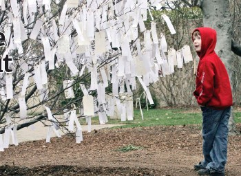 ?? — The ?? Lucas Pritchard of Rochester, N.Y., reads some of the wishes left by visitors on the Hirshhorn wish tree.