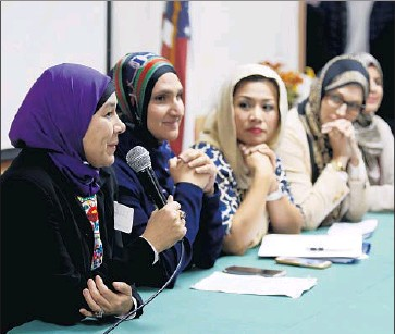 """?? Photographs by Francine Orr Los Angeles Times ?? LUCY SILVA, left, speaking at the #IStandWithHijabis event, was born in Mexico and grew up Catholic. After converting to Islam, Silva says, she had to reassure her parents. """"Look, Mom, I'm still Mexican, OK?"""""""