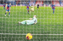?? POOL VIA AP ?? Crystal Palace goalkeeper Vicente Guaita watches as Newcastle score their second goal at Selhurst Park on Friday.