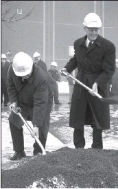 ?? Nancy King - Cape Breton Post ?? Lars-Ove Staff, left, a member of the Stora Enso Port Hawkesbury board, joined Premier John Hamm on March 18, 2003 in turning the sod to officially launch Stora's next construction project, a new thermomechanical pulp line to extend the life of the...