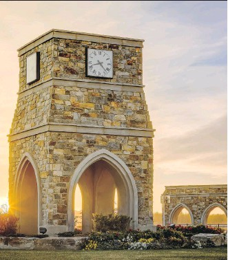 """??  ?? WestCreek Developments' Legacy was named Community of the Year-City of Calgary. Development manager Jared Goldade cites features such as the clock tower and """"the sense of arrival into the community."""""""