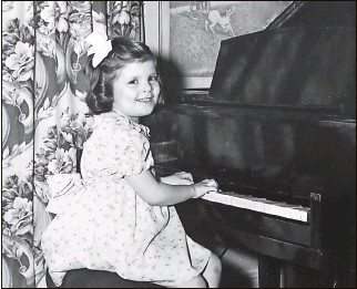 """?? Photos courtesy of Mila Turtle ?? Zola Shaulis started playing piano at age 3. When she was 7, the conductor of the Philadelphia Orchestra described her as having """"a marvelous talent, one that very few possess."""""""