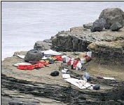 ?? Denis Poroy Associated Press ?? ITEMS FROM a boat that crashed and broke apart near the Cabrillo National Monument off the San Diego coast Sunday. At least three people were killed.