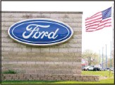??  ?? In this file photo, an American flag flies over a Ford auto dealership, in Waukee, Iowa. (AP)