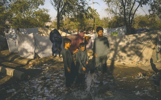 """?? BERNAT ARMANGUE/ASSOCIATED PRESS ?? Children on Monday at a Kabul camp for internally displaced Afghans. """"The people of Afghanistan need a lifeline,"""" U.N. Secretary General António Guterres said Monday."""
