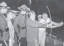 ??  ?? On Aug. 1, 1959, Premier W.A.C. Bennett shot a flaming arrow at $70 million of paid-off bonds on a barge in Okanagan Lake.