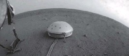 ?? NASA/JPL-CALTECH AP ?? Clouds drift over the dome-covered SEIS seismometer of the InSight lander on the surface of Mars. The quake-measuring device is providing the first detailed look at the red planet's interior.