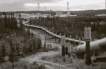 ?? Associated Press file photo ?? The Trans-Alaska pipeline and pump station north of Fairbanks, Alaska, is shown. The IEA said the oil and gas industry worldwide emitted more than 70 million metric tons of methane last year.