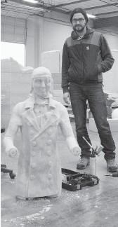 ??  ?? Jean-Sebastien Gauthier stands beside a foam model of the sculpture.