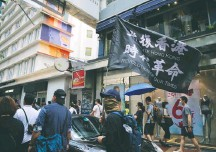 """?? Kin Cheung/associated PRESS ?? Protesters carry a flag that says """"Liberate Hong Kong, revolution of our times"""" before a march in Hong Kong on July 1, 2020."""