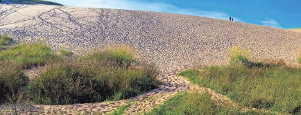 ?? RIVERNORTHPHOTOGRAPHY/GETTY IMAGES ?? Sleeping Bear Dunes National Lakeshore in Michigan offers sweeping sand mountains.
