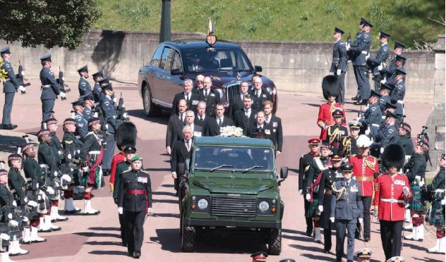 ?? Reuters ?? ↑ Members of the Royal Family follow the hearse, a specially modified Land Rover, during the funeral of Prince Philip on the grounds of Windsor Castle on Sunday.