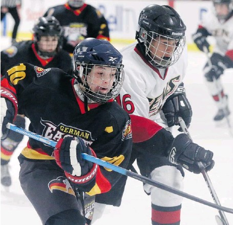 ?? JEAN LEVAC/OTTAWA CITIZEN ?? Justin Schütz, left, of the German Eagles, chases the puck against Joshua Thaggard of the Ottawa Senators during a major peewee AAA friendly at the Bell Sensplex Thursday. Also playing in advance of the Bell Capital Cup were four teams from Finland,...