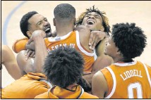 ?? THE ASSOCIATED PRESS ?? Texas guard Matt Coleman III is mobbed by teammates after hitting the game-winning shot to beat North Carolina in the Maui Invitational championship in Asheville, N.C. The Hawaii-based tourneywasmoved to North Carolina because of the pandemic.