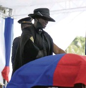 ?? MATIAS DELACROIX AP ?? Martine Moïse stands next to the casket of her husband, Jovenel Moïse, on Friday in Cap-Haïtien.
