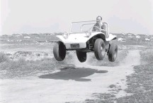 """?? ERIC RICKMAN/ENTHUSIAST NETWORK/GETTY IMAGES ?? Bruce Meyers, circa 1966, in a Meyers Manx. """"If I'd known a lot about car design, there wouldn't be a dune buggy because I broke the rules. You have to have freedom to break rules,"""" he said."""