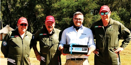 ??  ?? David Le Roux from PilotInsure accepts the Hired Gun presentation from the Flying Lions