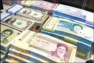 ?? (AP) ?? Iranian and US banknotes are on display at a currency exchange shop in downtown Tehran, Iran. Iran's currency is continuing its downward spiral as increased American sanctions loom, hitting a new low on the thriving black market exchange. The Iranian...