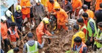 ?? (Niharika Kulkarni/Reuters) ?? RESCUE WORKERS search for survivors after a residential house collapsed due to landslide caused by heavy rainfall in Mumbai yesterday.