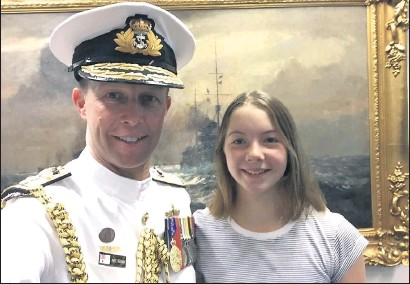 ??  ?? Bonded: Rear Admiral Michael Noonan and daughter Jaimie, who was christened on the HMAS Parramatta, the Rear Admiral's first command.